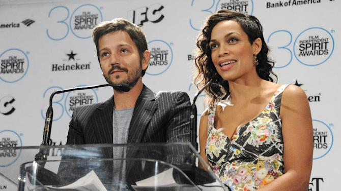 Diego Luna, left, and Rosario Dawson announce the nominations for the 30th Annual Independent Spirit Award Nominations at a press conference on Tuesday, Nov. 25, 2014, in Los Angeles. (Photo by Richard Shotwell/Invision/AP)