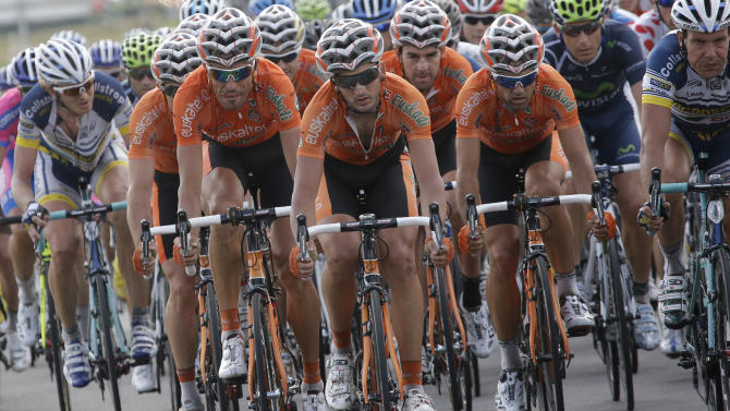 Team Euskaltel-Euskadi rides in the pack during the fourth stage of the Tour de France cycling race over 214.5 kilometers (133.3 miles) with start in Abbeville and finish in Rouen, France, Wednesday July 4, 2012. (AP Photo/Christophe Ena)