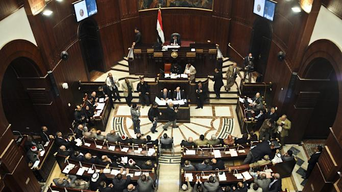Members of the constitutional assembly attend a session at the Shura Council building in Cairo, Egypt, Wednesday, Dec. 26, 2012. The official approval of Egypt's disputed, Islamist-backed constitution Tuesday held out little hope of stabilizing the country after two years of turmoil and Islamist President Mohammed Morsi may now face a more immediate crisis with the economy falling deeper into distress. (AP Photo/Mohammed Asad)