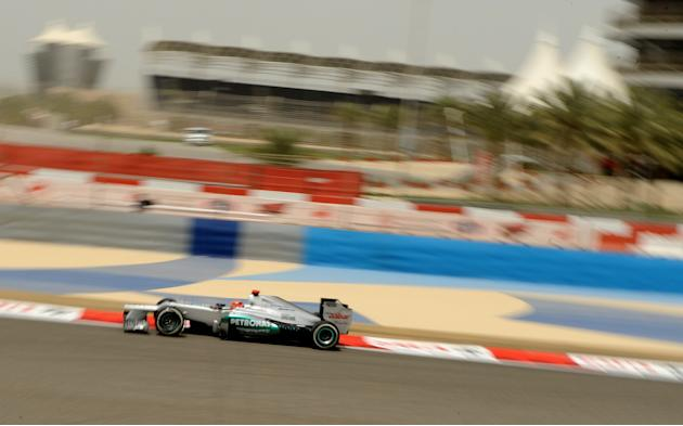 drives on April 20, 2012 during the first practice session at the Bahrain international circuit in Manama ahead of the Bahrain Formula One Grand Prix.   AFP PHOTO / Tom Gandolfini (Photo credit should