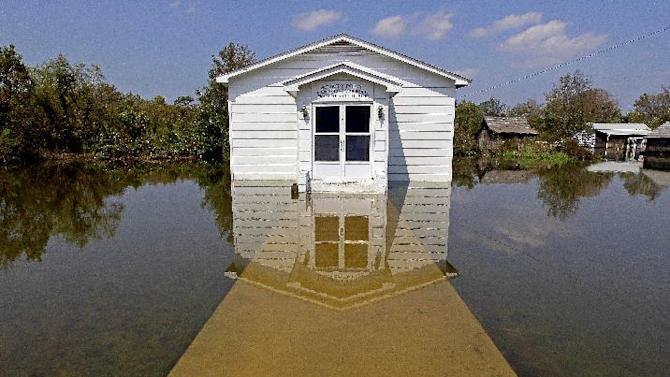 The Stumpy Point Congregational Holiness Church is shown surrounded by water following the effects of Hurricane Irene in Stumpy Point, N.C., Sunday, Aug. 28, 2011. The storm that spent 12-hours scouring the North Carolina coast killed at least five people, brought pockets of flooding that required rescues along the sounds and left nearly a half-million customers without power. (AP Photo/Gerry Broome)