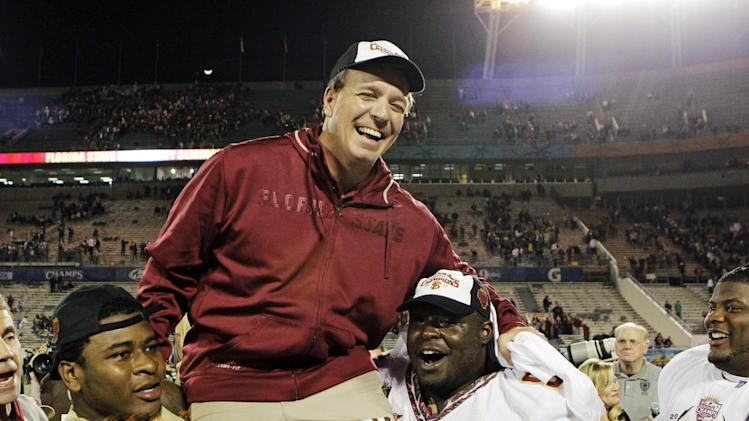 Florida State players carry head coach Jimbo Fisher off the field after they defeated Notre Dame 18-14 in the Champs Sports Bowl NCAA college football game, Thursday, Dec. 29, 2011, in Orlando, Fla. (AP Photo/John Raoux)
