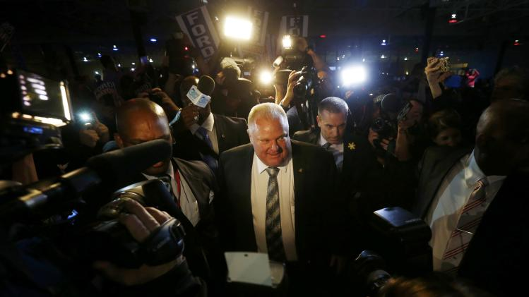 Toronto Mayor Rob Ford enters convention centre before addressomg supporters during his campaign launch party in Toronto