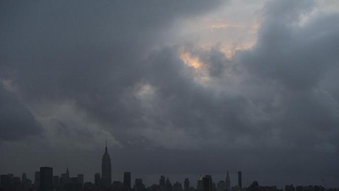 This Tuesday, Oct. 30, 2012 photo shows the Empire State Building and large portions of New York's midtown Manhattan without power as a result of Superstorm Sandy. An Associated Press analysis of outage times from other big hurricanes and tropical storms suggests that, on the whole, the utility response to Sandy, especially in hardest-hit New York and New Jersey, was typical - or even a little faster than elsewhere after other huge storms. (AP Photo/Charles Sykes)