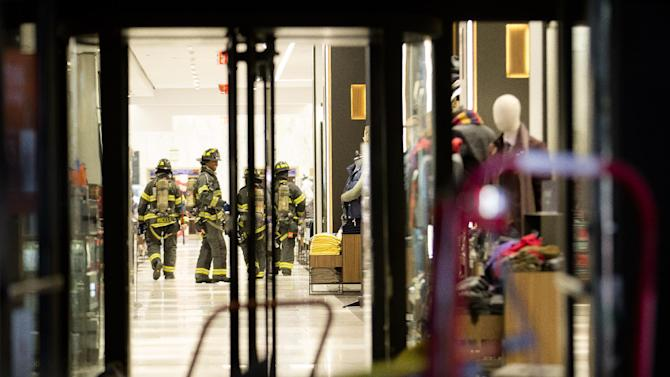 Firefighters walk through the Macy's flagship Herald Square store after responding to a reported second alarm fire inside the building, Friday, Oct. 25, 2013, in New York. The two-alarm blaze broke out about 8:15 p.m. Friday in the basement of the iconic department store on 34th Street in Manhattan. The building was evacuated, and the fire was out by about 9:15 p.m. (AP Photo/John Minchillo)