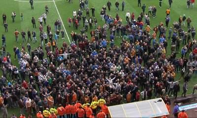 Wolves Fans Invade Pitch After Burnley Defeat