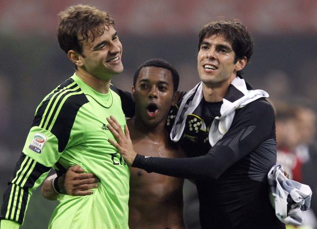 AC Milan's Gabriel, Robinho and Kaka celebrate their win at the end of their Italian Serie A soccer match against Udinese in Milan