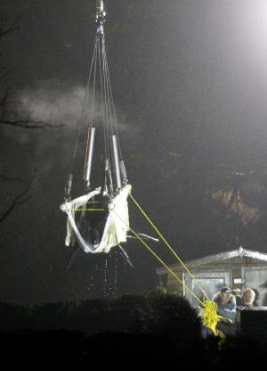 The 1,400 kilogram (3,085 pound) female orca named Morgan is hoisted by crane into a container on a truck at the Dolfinarium in Harderwijk, Netherlands, early Tuesday Nov. 29,  2011. A Dutch dolphin park has loaded a young killer whale into a container on a truck ahead of her transfer by plane to amusement park Loro Parque on the Spanish island of Tenerife later Tuesday after conservationists lost a legal battle to have her released. (AP Photo/Bas Czerwinski)