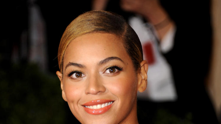 "FILE - This May 7, 2012 file photo shows Beyonce Knowles at the Metropolitan Museum of Art Costume Institute gala benefit in New York. Beyonce will sing the national anthem at President Barack Obama's inauguration ceremony. The committee planning the Jan. 21 event also announced Wednesday that Kelly Clarkson will perform ""My Country `Tis of Thee"" and James Taylor will sing ""America the Beautiful"" at the swearing-in ceremony on the Capitol's west front.  (AP Photo/Evan Agostini, File)"