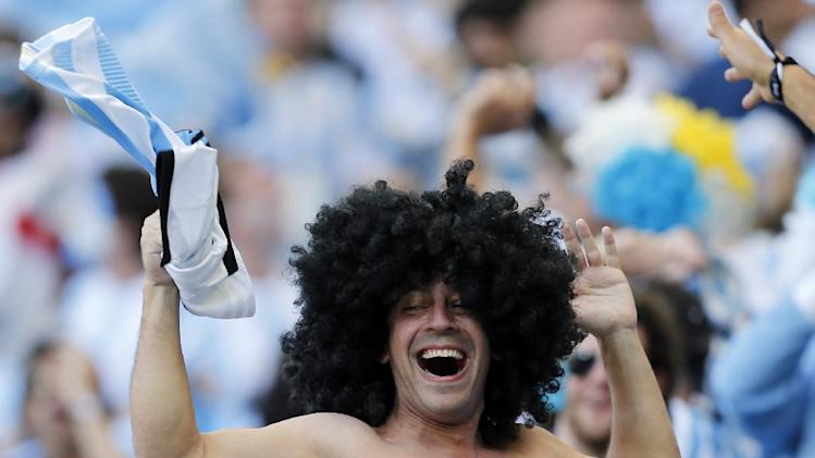 Argentine fans celebrate after the group F World Cup soccer match between Argentina and Iran at the Mineirao Stadium in Belo Horizonte, Brazil, Saturday, June 21, 2014. Argentina won the match 1-0