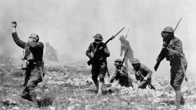 American soldiers during World War I stage a photo illustrating the ill effects of forgetting one's gas mask.