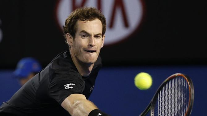 Andy Murray of Britain makes a backhand return to Tomas Berdych of the Czech Republic during their semifinal match at the Australian Open tennis championship in Melbourne, Australia, Thursday, Jan. 29, 2015. (AP Photo/Vincent Thian)