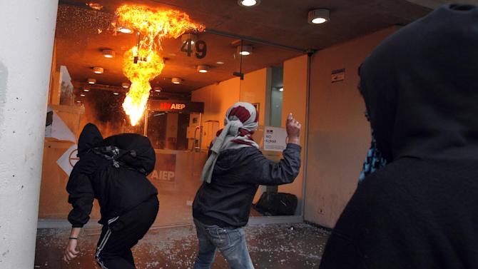 AP10ThingsToSee - Demonstrators throw Molotov cocktails and rocks at an institute of technology during a nationwide demonstration in Santiago, Chile, Wednesday, June 26, 2013. (AP Photo/Luis Hidalgo, File)