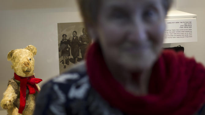 """Holocaust survivor Stella Knobel, poses next to her teddy bear during a new exhibition of Israel's national Holocaust memorial and museum in Jerusalem, Sunday, Jan. 27, 2013. When Stella Knobel's family had to flee World War II Poland in 1939, the only thing the 7-year-old girl could take with her was her teddy bear. For the next six years, the stuffed animal never left her side as the family wondered through the Soviet Union, to Iran and finally the Holy Land. """"He was like family. He was all I had. He knew all my secrets,"""" the 80-year-old now says with a smile. """"I saved him all these years. But I worried what would happen to him when I died."""" So when she heard about a project launched by Israel's national Holocaust memorial and museum to collect artifacts from aging survivors - before they, and their stories, were lost forever - she reluctantly handed over her beloved bear Misiu - Polish for """"Teddy Bear""""- so the fading memories of the era could be preserved for others. (AP Photo/Ariel Schalit)"""