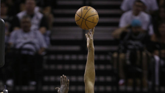 Oklahoma Thunder's Kevin Durant, center, scores over San antonio Spurs' DeJuan Blair (45) during the second quarter of an NBA basketball game, Thursday, Nov. 1, 2012, in San Antonio. (AP Photo/Eric Gay)