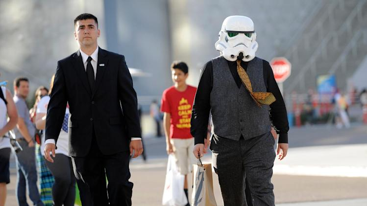 Actor Jack Black, wearing a Star Wars Stormtrooper mask, right, walks outside the convention center on Day 1 of Comic-Con International on Thursday, July 24, 2014, in San Diego. (Photo by Chris Pizzello/Invision/AP)