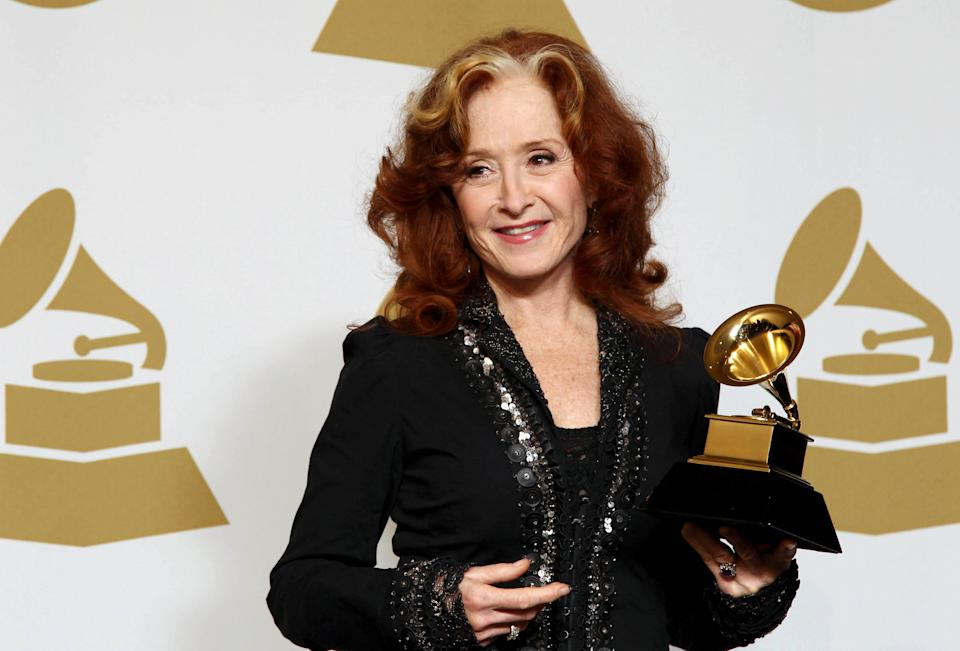 "Bonnie Raitt poses backstage with the award for best americana album for ""Slipstream"" at the 55th annual Grammy Awards on Sunday, Feb. 10, 2013, in Los Angeles. (Photo by Matt Sayles/Invision/AP)"
