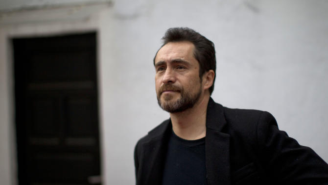 """In this photo taken on Feb. 16, 2012, Mexican actor Demian Bichir poses for a portrait in Mexico City, Mexico.  Bichir learned an important lesson when he left his native Mexico to launch a U.S. acting career and ended up working in a Mexican restaurant in New York: How to live the invisible life of an illegal immigrant with dignity. It's a subtle quality he brings to his Oscar-nominated role of Los Angeles gardener Carlos Galindo in the movie """"A Better Life.""""  (AP Photo/Dario Lopez-Mills)"""