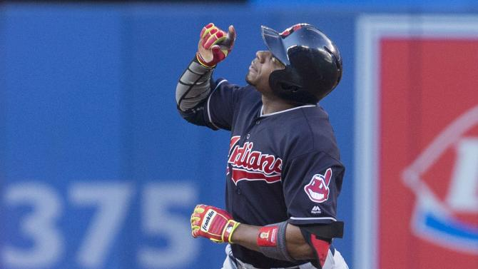 Cleveland Indians' Rajai Davis gestures as he rounds the bases after hitting a solo home run off Toronto Blue Jays' starting pitcher R.A. Dickey during the second inning of a baseball game Thursday, June 30, 2016, in Toronto. (Chris Young/The Canadian Press via AP)