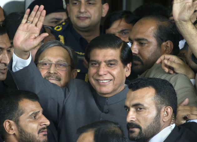 Pakistan's Prime Minister Raja Pervaiz Ashraf waves upon arriving at the Supreme Court for a hearing where he will submit his reply regarding the court's order to reopen an old corruption case against the country's president, in Islamabad, Pakistan on Tuesday, Sept. 18, 2012. (AP Photo/Anjum Naveed)