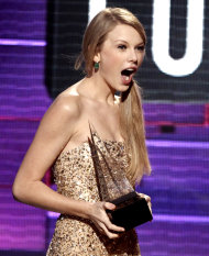 Taylor Swift accepts the award for country favorite female artist at the 39th Annual American Music Awards on Sunday, Nov. 20, 2011 in Los Angeles. (AP Photo/Matt Sayles)