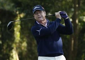 U.S. golfer Tom Watson hits his tee shot on the second hole during the first round of the 2014 Masters golf tournament at the Augusta National Golf Club in Augusta
