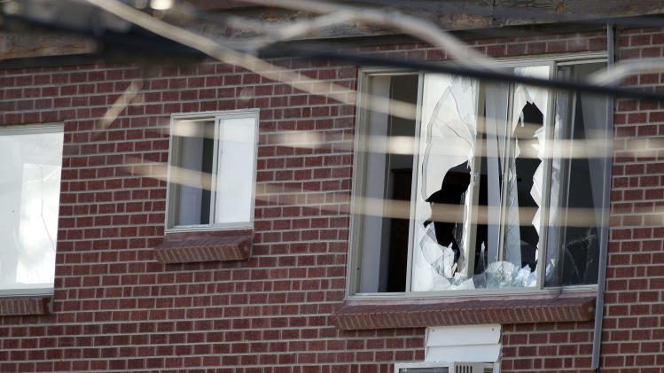 "Windows are broken at the apartment of the alleged gunman James Holmes, 24, Friday, July 20, 2012 in Aurora, Colo. Authorities report that 12 died and more than three dozen people were shot during an assault at the theatre during a midnight premiere of ""The Dark Knight. (AP Photo/Alex Brandon)"