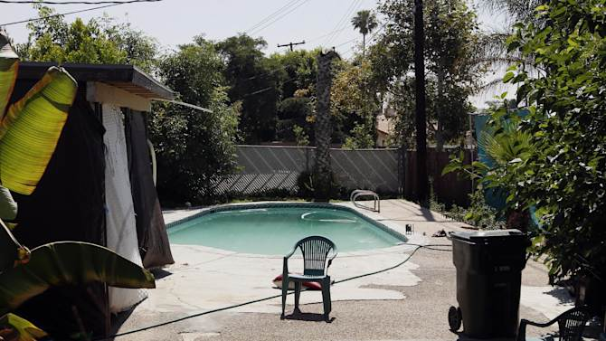 The swimming pool at Rodney King's home is seen in Rialto, Calif., Sunday, June 17, 2012. King, the black motorist whose 1991 videotaped beating by Los Angeles police officers was the touchstone for one of the most destructive race riots in U.S. history, died Sunday. He was 47. King's fiancee called police to report that she found him at the bottom of the swimming pool at their home in Rialto, Calif,, police Lt. Dean Hardin said. (AP Photo/Jae C. Hong)