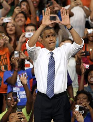 "President Barack Obama does the sign of ""The U"" as he arrives a campaign event at the University of Miami, Thursday, Oct. 11, 2012, in Coral Gables, Fla. (AP Photo/Lynne Sladky)"
