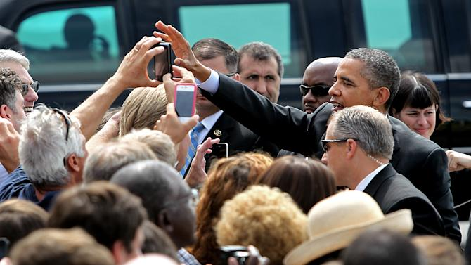 President Barack Obama greets supporters at Wiggins FBO in Manchester, N.H., Saturday August 18, 2012.  (AP Photo/Cheryl Senter)