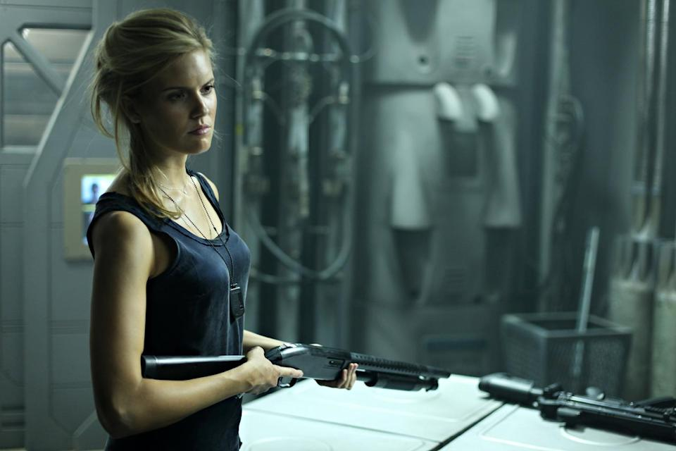 "In this film image released by Film District, Maggie Grace is shown in a scene from ""Lockout."" (AP Photo/Film District)"