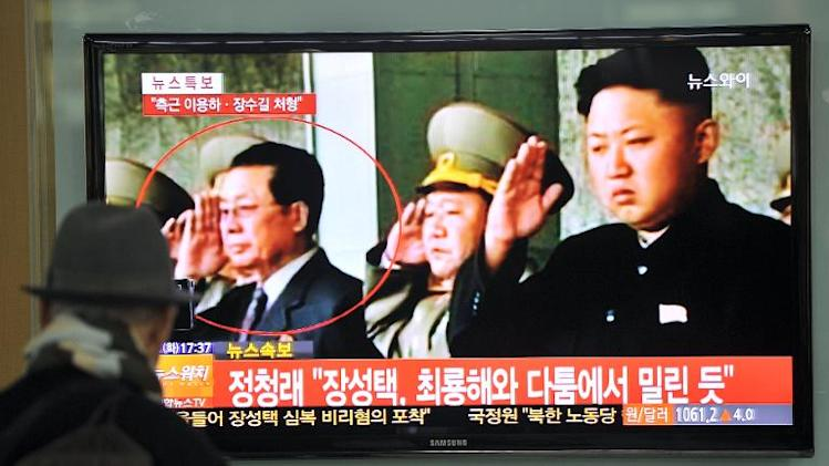 A man watches a news broadcast on the dismissal of Jang Song-Thaek, North Korean leader Kim Jong-Un's uncle, at a railway station in Seoul on December 3, 2013
