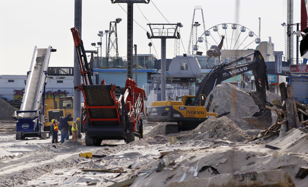 <p>               Crews work work to replace the Superstorm Sandy destroyed boardwalk in Seaside Heights, N.J., Thursday, Jan. 3, 2013.   Under intense pressure from angry Republicans, House Speaker John Boehner has agreed to a vote this week on aid for Superstorm Sandy recovery.  (AP Photo/Mel Evans)