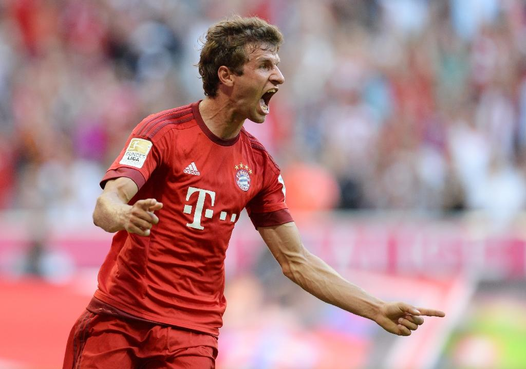 Mueller double helps Bayern go top of Bundesliga