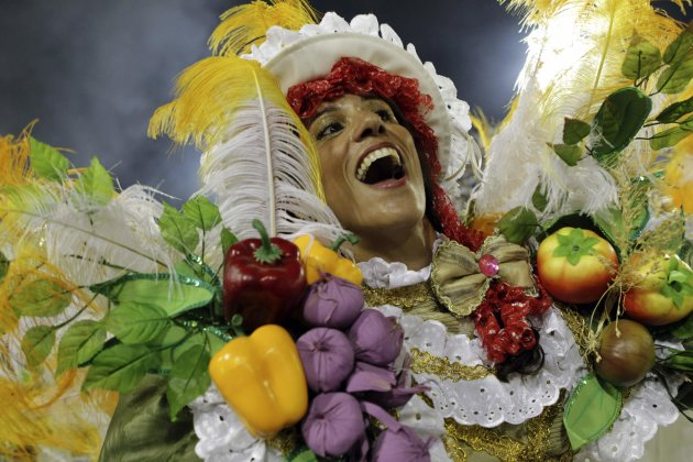 A reveller from the Unidos da Tijuca samba school takes part in the second night of the annual Carnival parade in Rio de Janeiro's Sambadrome