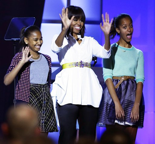"First lady Michelle Obama, center, and daughters Sasha, left, and Malia, right, react during the Kids' Inaugural: Our Children. Our Future."" event in Washington, Saturday, Jan. 19, 2013, as part of the 57th Inauguration weekend of events. (AP Photo/Frank Franklin II)"