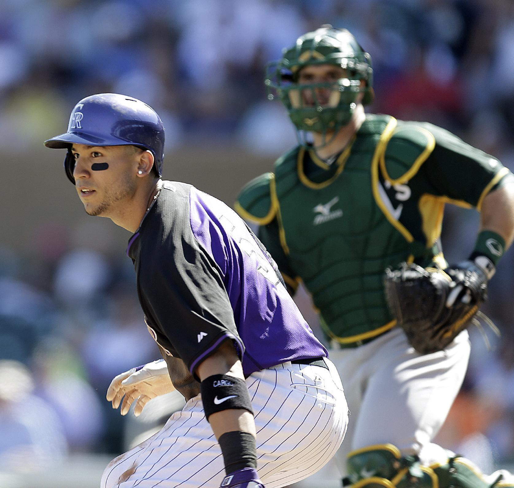 Rockies' Carlos Gonzalez say he is OK after knee scare