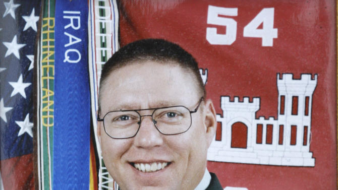 FILE - This U.S. Army photo made available by the Russell  family on Tuesday, May 12, 2009 shows U.S. Army Sgt. John M. Russell.  Russell   pleaded guilty Monday to killing four other soldiers and a Navy officer in 2009 at mental health clinic in Baghdad during the Iraq War.  The plea agreement in a military court at Joint Base Lewis-McChord means Russell will avoid the death sentence. His maximum sentence would be a life term. He testified Monday to persuade Army judge Col. David Conn to accept the agreement. Conn agreed. (AP Photo/Family photo)