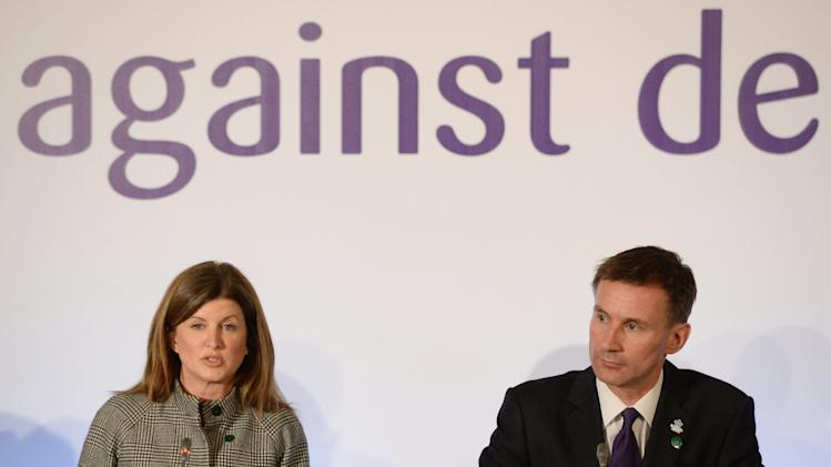 Canadian Health Minister Rona Ambrose and Britain's Health Secretary Jeremy Hunt attend a news conference at the G8 Dementia Summit, at Lancaster House in central London