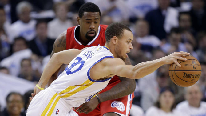 Golden State Warriors' Stephen Curry (30) dribbles around Los Angeles Clippers' DeAndre Jordan during the first half of an NBA basketball game in Oakland, Calif., Wednesday, Jan. 2, 2013. (AP Photo/Marcio Jose Sanchez)