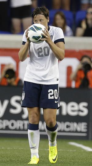 United States' Abby Wambach kisses a soccer ball after scoring against South Korea during the first half of an international friendly soccer match at Red Bull Arena, Thursday, June 20, 2013, in Harrison, N.J. With the goal, Wambach broke Mia Hamm's national goal-scoring record. (AP Photo/Julio Cortez)