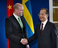 Chinas's Prime Minister Wen Jiabao (R) shakes hands with his Swedish counterpart Fredrik Reinfeldt prior to a meeting at the government chancellery in Stockholm. Five bilateral trade deals were signed between the two countries, and six agreements with companies