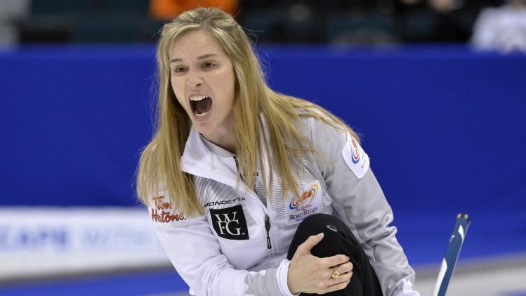 Skip Jones yells instructions to sweepers against Team Middaugh during the women's final at the Roar of the Rings Canadian Olympic Curling Trials in Winnipeg