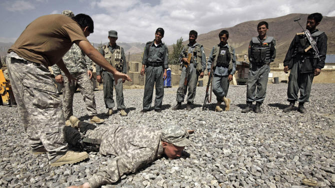 FILE - In this Saturday, Sept. 19, 2009 file photo, U.S. Army Sgt. William Womack, 23, from Batesville, Ga., of the 118th Military Police Co., based at Fort Bragg, N.C., is prone during a training session for the Afghan National Police at a combat outpost in the Jalrez Valley in Afghanistan's Wardak Province. U.S. soldiers serving in one of southern Afghanistan's most violent areas say they are successfully training the Afghans to secure their country and their progress so far will play a large role in determining how many more American troops President Barack Obama sends home next year. (AP Photo/Maya Alleruzzo, File)