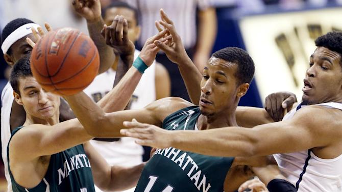 Pittsburgh's Derrick Randall, right, and Manhattan's Calvin Crawford (14) scramble for  a rebound during the first half of an NCAA college basketball game Wednesday, Dec. 17, 2014, in Pittsburgh. Pittsburgh won 65-56. (AP Photo/Keith Srakocic)