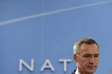 NATO Secretary General Stoltenberg looks down during a NATO foreign ministers meeting at the Alliance's headquarters in Brussels