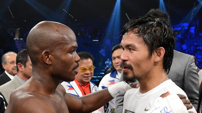 (L-R) Timothy Bradley And Manny Pacquiao Talk In The Ring Getty Images