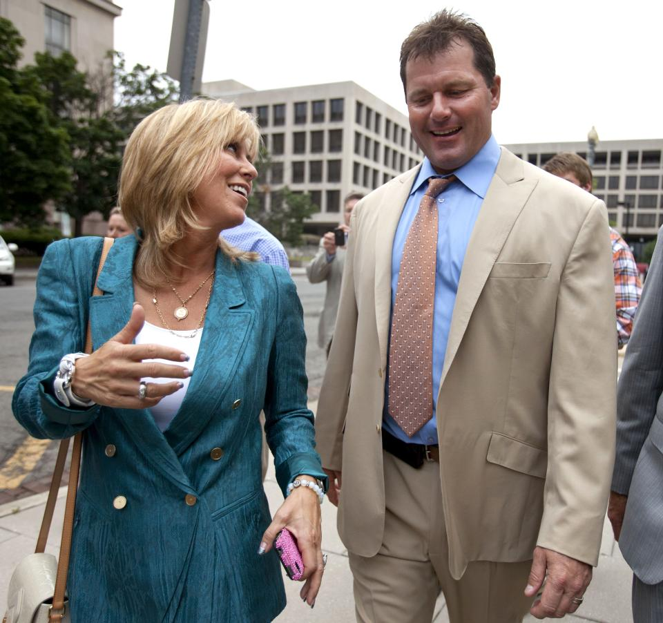 Debbie Clemens, left, smiles while leaving federal court with her husband, former Major League Baseball pitcher Roger Clemens in Washington, Monday, June 18, 2012, after he was acquitted on all charges by a jury that decided that he didn't lie to Congress when he denied using performance-enhancing drugs. (AP Photo/Jacquelyn Martin)