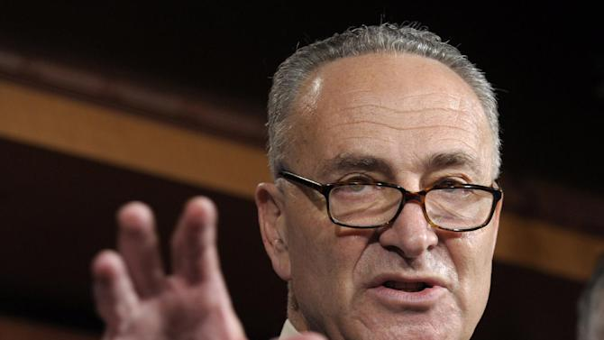 """FILE - In this May 17, 2012 file photo, Sen. Charles Schumer, D-N.Y. gestures during a news conference on Capitol Hill in Washington. Republican leaders say the government can raise tax """"revenue"""" without raising tax """"rates."""" But how? If Congress reduces itemized deductions, many Americans will still pay more taxes. This politically tricky tradeoff is about to take center stage in negotiations over averting a national """"fiscal cliff."""". (AP Photo/Susan Walsh, File)"""