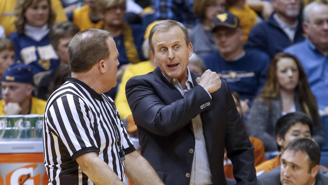 Texas head coach Rick Barnes argues with an official during the second half of an NCAA college basketball game at WVU Coliseum in Morgantown, W.Va., on Monday, Feb. 4, 2013. West Virginia defeated Texas 60-58. (AP Photo/David Smith)